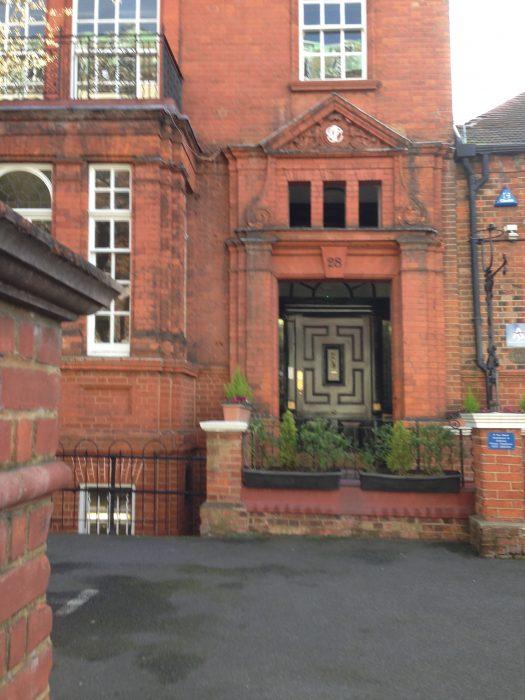 Artist John O'Connor's initials over his studio door
