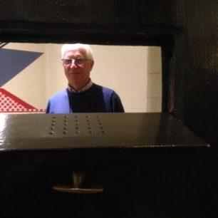 David Niccol looking through cell door 2019