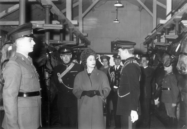 View of Queen Elizabeth II inspecting the stables of the Royal Horse Artillery at St John's Wood Barracks, November 1962 | Copyright Westminster City Archives
