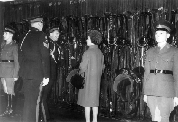 View of Queen Elizabeth II inspecting the tack room of the Royal Horse Artillery at St John's Wood Barracks, November 1962 | Copyright Westminster City Archives