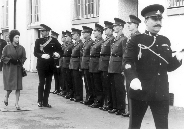 View of Queen Elizabeth II inspecting a guard of honour composed of members of of the Royal Horse Artillery at St John's Wood Barracks, November 1962 | Copyright Westminster City Archives