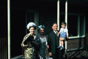 Clarke family with Michael Sharman leaving for Charles Sharman's christening 1960