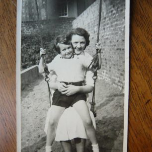 Judy on her friend Isabel's lap on the swing | Judy Hame