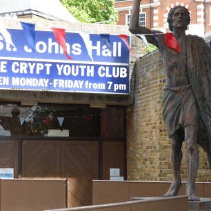 Statue of St John by Hans Feibusch decorated for the occasion | Louise Brodie