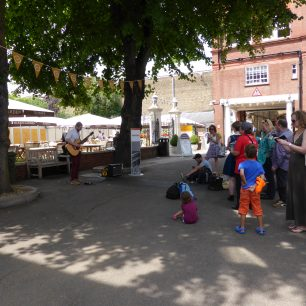Entertainment round the ground: listening to a guitarist | Louise Brodie