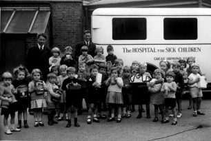 1937 Barrow Hill School Reg Page just below the HO on side of ambulance, holding a box of Quaker Oats | Reg Page
