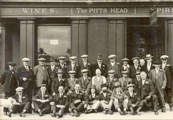 Edward Parsons landlord of the Pitts Head, 74 Henry Street with a group of men prior to going on an outing, 1935.From left to right: Back row - Richard Carroll, Steven Jordan, ?, Nobbler Lake, William Jordan, ?, Tom Beddows, Ben Skinner, ?, Ike Clarke, Knight, Edward Parsons jnr, ?, (Driver) Middle Row: ?, Tim Rice, ?, Edward Parsons snr, Robert Culverhouse, ?, George Rumble, Walter Rumble, ?  Front Row: ?, James Ford, Perry, John Rumble, Arty Goff, Goodyear, Jerry Clements, George HardingNorman Harnden front row extreme right | Copyright Westminster City Archives
