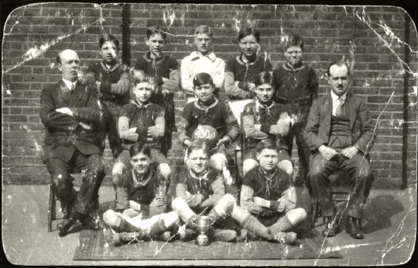 Barrow Hill Road School, football team, 1930-1931,Teachers: Left Mr Purvis (Headmaster, Right Mr Collins | Copyright Westminster City Archives