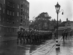 Marching past Townshend  Court on Frederick Street (now Mackennal Street). Townshend Road at rear of picture | IWM