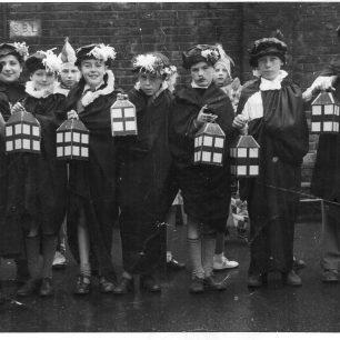 Dressed as carol singers