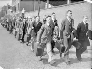 Marching with kit to enrol   IWM CH10988