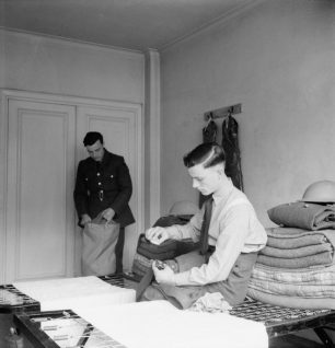 Unpacking in a luxury flat | IWM CH 10990